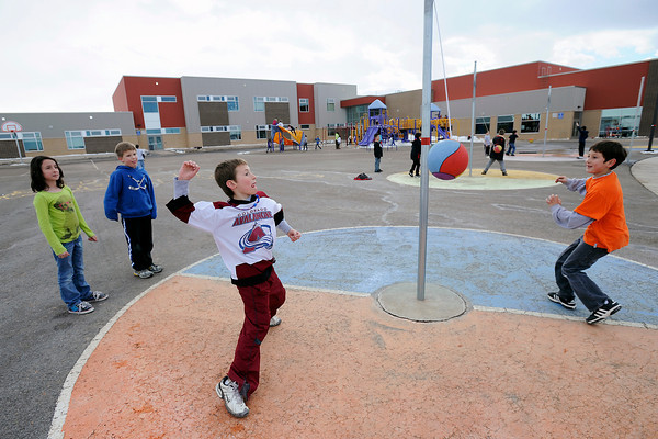 Ponderosa Elementary School second-graders Elora Ayoub, 8, left, and Jack Stegner, 8, look on while classmates Brock Saya, 8, and Coletin Renn, 7, play a game of tetherball Thursday, Feb. 9, 2012 on the school's playground at recess.