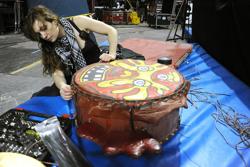 Cirque du Soleil swing tech carpenter Angela Everett repairs a drum head Tuesday at the Budweiser Events Center in preparation for the performance Dralion which continues through Sunday at the BEC.