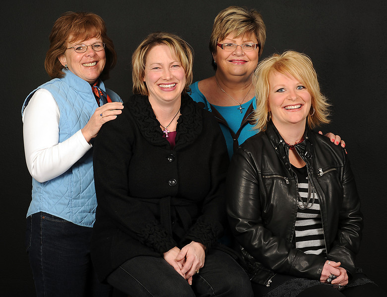 Birth mothers volunteers, called Friends, help pregnant women connect with resources and offer them friendship and caring. Four of the members pose for a photo. From left they are Jan Schmidtbauer, Lorraine Meyer, Patty Suttner, and Kimberly Peterson. Photo by Jenny Sparks
