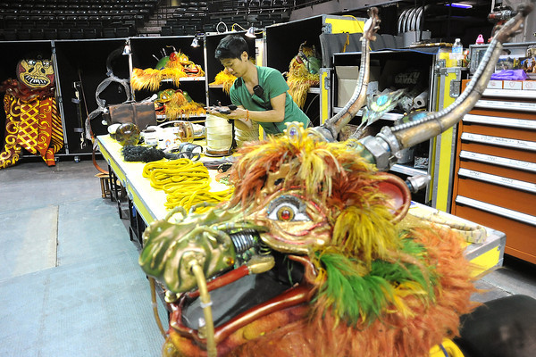 Props technician Kevin Chung works behind the stage Tuesday at the Budweiser Events Center in preparation for the show Dralion which runs through Sunday at the BEC.