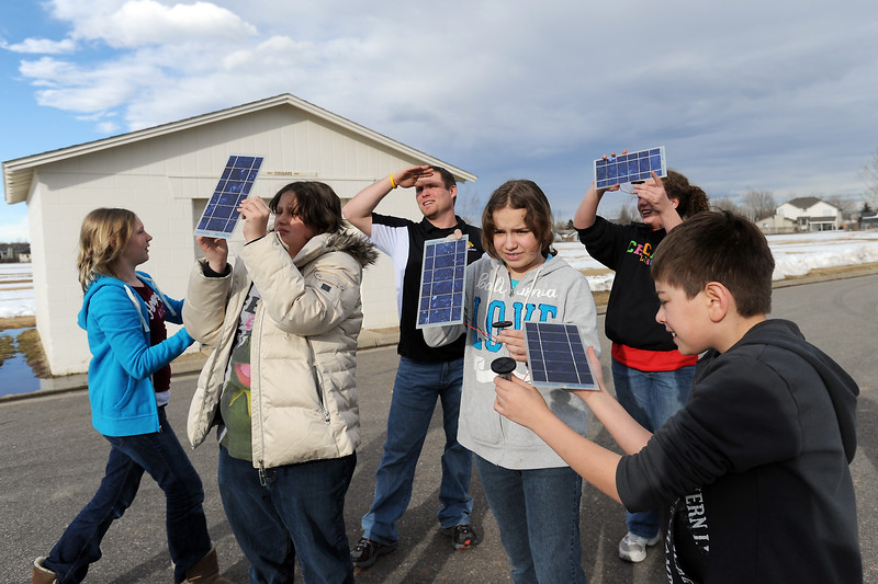Members of Walt Clark Middle School's Green Team experiment with small solar panels outside the school during a meeting of the club. From left are Heather Hartzog, 12, Sierra Place, 12, instructor Sol Miller, Alex Aust, 12, Hannah Elyse Hogle, 13, and Christian Mendoza, 12.