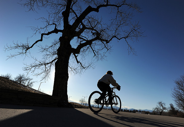Kara Brochu of Loveland rides her bike on the Recreation Trail near Centennial Park Friday in Loveland. Photo by Jenny Sparks