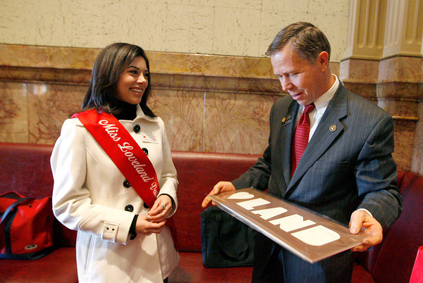 State Senator, Kevin Lundberg, holds a present that Miss Loveland Valentine, Jamie Felton, gave him during a tour the State Capitol on Monday in Denver. Photo by Gabriel Christus