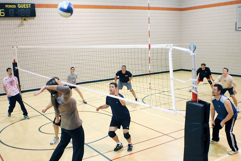 Loveland resident Keri Eichinger, front left, goes up for a spike while playing volleyball Tuesday evening in the small gymnasium at the Chilson Recreation Center. The rec center hosts drop-in volleyball every Tuesday from 6:30 p.m. to 9:30 p.m. where participants divide up into teams and play against each other in friendly competitions.