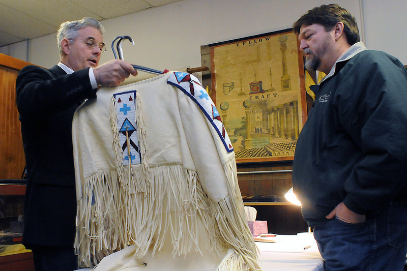 Antique appraiser Daniel Geary, left, examines a Native American dance dress for Berthoud resident Blake Dye during the Berthoud Historical Society's Antique Appraisal Day at the Little Thompson Valley Pioneer Museum on Saturday.