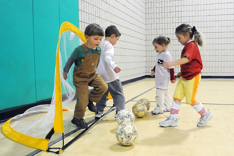 Youngsters work on a drill during a pre-kindergarten to kindergarten age indoor soccer class on Tuesday afternoon in the small gymnasium at the Chilson Recreation Center. From left are Owen Walsh, 3, Cole Broccoli, 5, Eva Wald, 4, and Julia Lukton, 4.