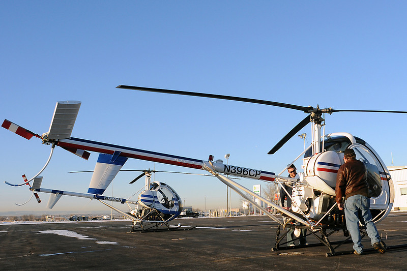 Front Range Helicopters chief pilot Don Griffith, right, and flight student Jory Camille of Windsor exit a helicopter after a check ride Wednesday afternoon at the Fort Collins/Loveland Municipal Airport.