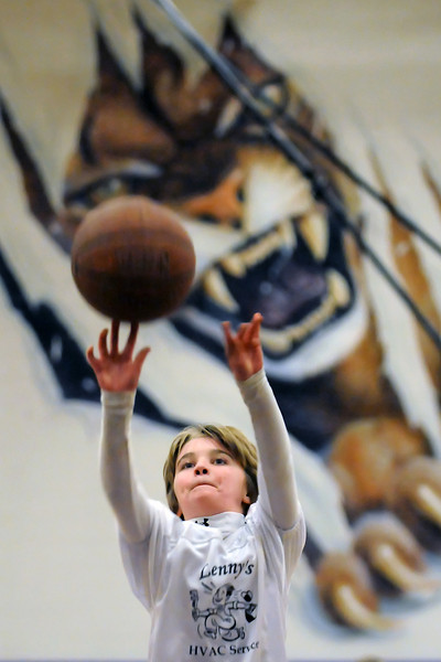 Ten-year-old Shane Shadowen shoots a basket in the gymnasium at Mountian View High School during halftime of the Mountain Lions' game against the Warriors of Centaurus on Thursday night.