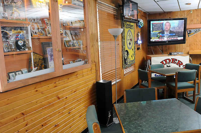 "The back room at Slider's Sports Bar & Grill in Fort Collins is decorated with a variety of Pittsburgh Steelers memorabelia like photos of players on the NFL football team, banners and also a yellow ""Terrible Towel."""