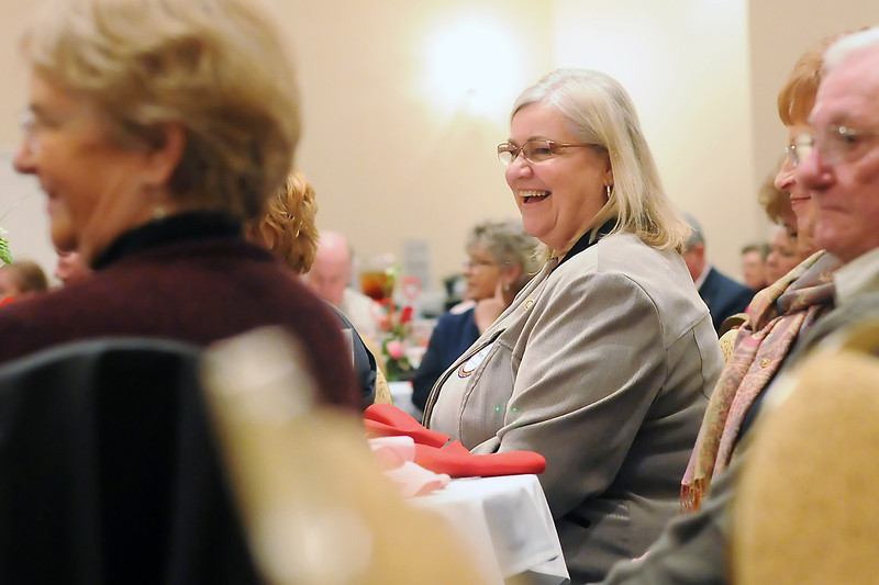 House of Neighborly Service executive director Glorie Magrum, center, is all smiles after being named the Loveland Rotary Club's Citizen of the Year during a Rotary event Tuesday at The Fountains.