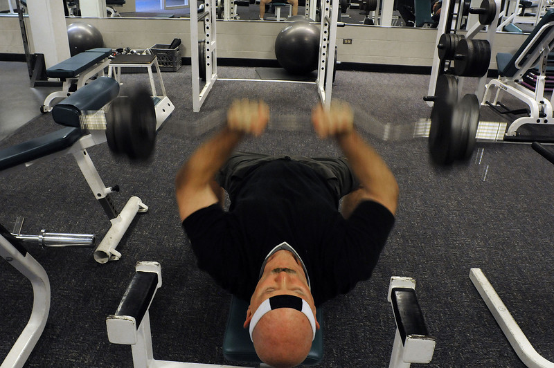Roger Norris of Berthoud works out his triceps on Thursday at the Chilson Recreation Center. Crews will break ground to expand the center in mid February, giving visitors an expanded weight room, cardio area, pool, and gymnastics areas.
