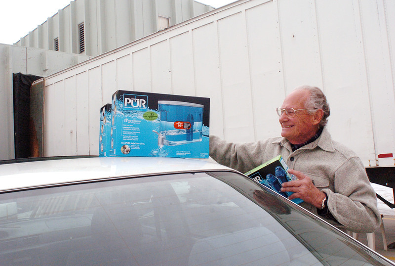Milliken resident Ronald Mallett prepares to drop off several water filtration kits at the H.E.L.P. International warehouse in Loveland on Tuesday that will be sent to Haiti to help victims of the recent earthquake.