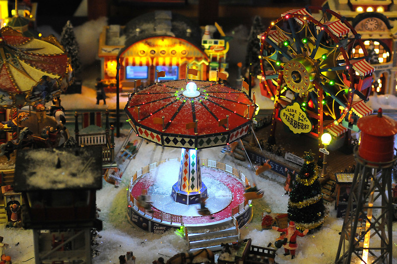 Sterling Myers train set includes carnival scenes and scenes from trainyards from the early 20th Century.
