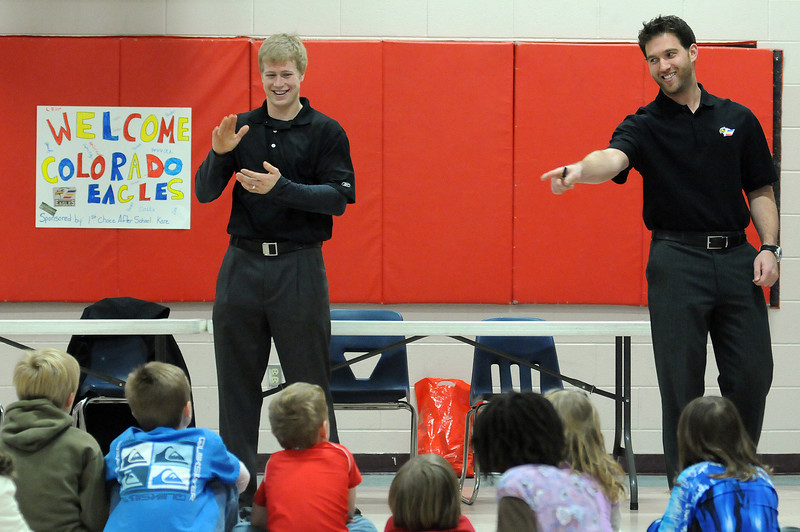 Colorado Eagles defenseman Jason Lundmark, left, and goalie Mike Mole talk with students at Mary Blair Elementary School on Tuesday during a 1st Choice After School Kare program. The program is designed to support students with activities and tutoring during after school hours that help them spend more time with their families while at home.