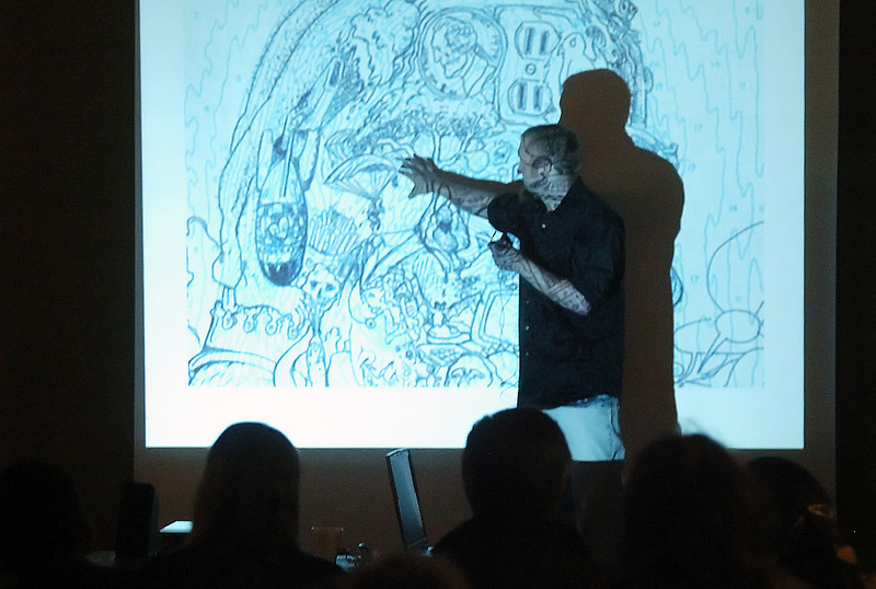 "Artist Donald Fodness talks about one of his Slavador Dali-inspired drawings Saturday during a presentation called ""Dali and Me!"" at the Loveland Museum/Gallery."