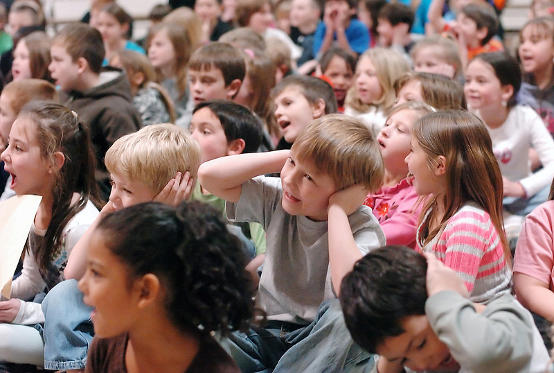Six-year-old Boz Freiling, center, covers his ears as Centennial Elementary School students around him yell during an assembly to kick off participation in the Rachel's Challenge program. The program's goal is to create a safe learning environment and prevent violence and bullying.