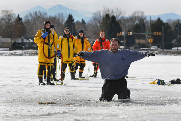 Jim Stewart, training coordinator for the Larimer County Dive Rescue Team, plays the part of a drowning victim during training for ice rescue on Lake Loveland. Members from Loveland Fire and Rescue, Berthoud Fire Protection District and Estes Valley Volunteer Fire Department participated in the training so all of the agencies could be trained in the same techniques and coordinate on large scale rescues in which several agencies are dispatched.