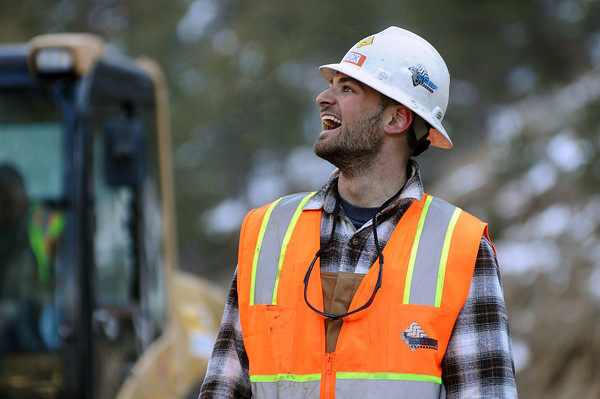 Foreman Mick Schuhmacher of SEMA Construction talks with Tim Dikeman, out of frame, on Monday as the two work on a bridge just east of mile marker 66 on U.S. 34 near Estes Park.