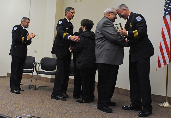 Police Chief Luke Hecker, right, congratulates Sgt. John Teeples as he presents him with the Loveland Police Medal of Honor on Thursday during the Loveland Police Awards at the Loveland Police and Courts building. Teeples was awarded for saving the life of a fellow officer by fatally shooting a man who was holding the other officer hostage in 1972 when he was on the force. From left are Cpt. Ray Miller, Cpt. Rob McDaniel and Sgt, Teeples wife Sharon Teeples.