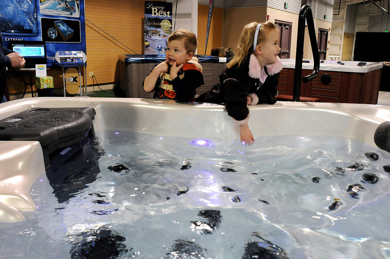 Grant Johnson, 2, of Johnstown, left, and Kylee Koch, 5, of Windsor play in a jacuzzi tub during the Northern Colorado Home Improvement Show on Saturday at The Ranch. The show provided home improvement ideas for residents of Northern Colorado and, according to event organizers, many people are choosing to do their own improvement in this difficult econcomy.