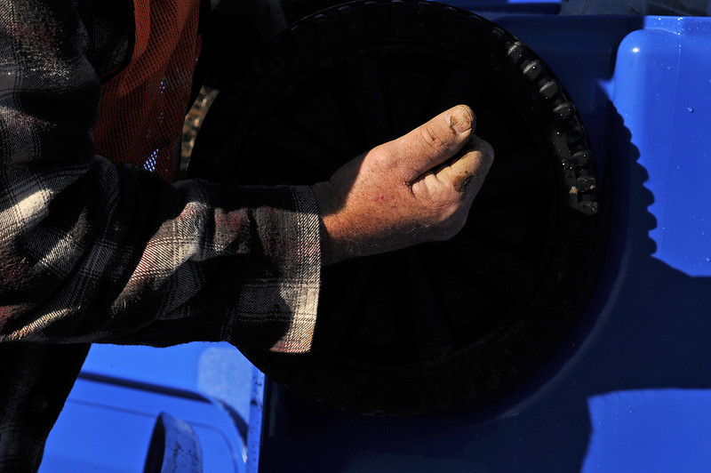 Jeff Stock of Loveland attaches wheels to a recycling cart at the Loveland Water Treatment Plant on Nov. 29.