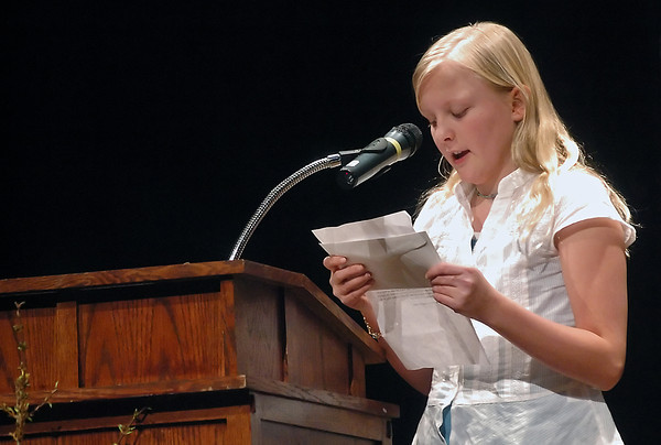 "Bill Reed Middle School sixth grader Alia Jackson, 11, reads from her award-winning essay titled ""Speakin Out For Justice"" during the Martin Luther King Day celebration Monday night at  Thompson Valley High School."