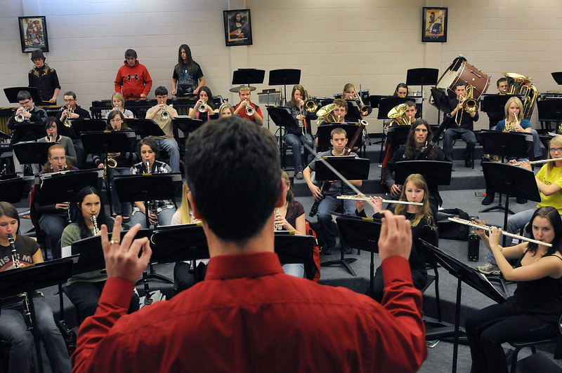 Head Band Director Matthew Arau leads the Loveland High School wind symphony on Friday during a class at Loveland High School.