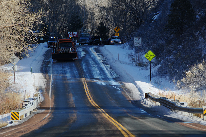 A shady and icy patch of road is visible near 9019 W. U.S. 34 on Monday. A motorist traveling eastbound hit the patch of ice and collided with a westbound vehicle.