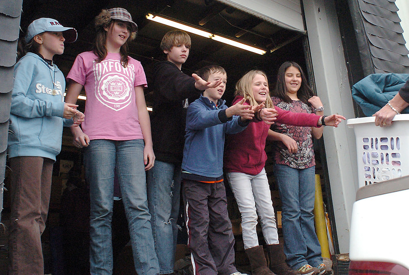 Youngsters help unload items donated for Haiti disater relief at the loading dock of H.E.L.P. International in Loveland on Tuesday. From left are Ella Price, 10, Millie Withrow, 11, Jack Withrow, 13, John Bednarek, 9, Lola Withrow, 9, and Magdalen Mercado, 10.