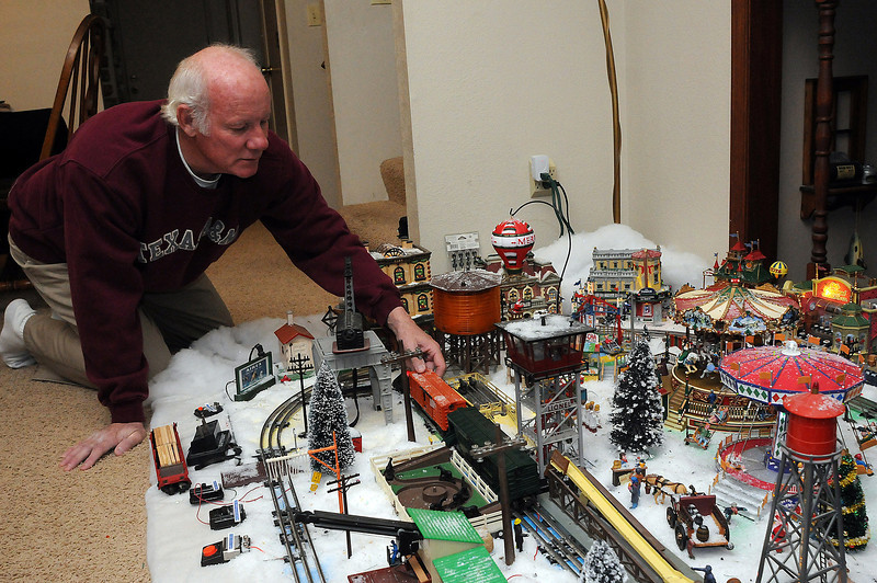 Sterling Myers shows off his toy trains from the early part of the 20th Century at his home in Berthoud. Myers collects the trains but also takes the 50 plus hours every holiday season to set a scene up for neighborhood and church kids.