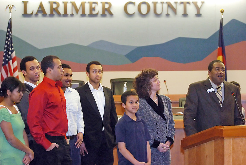 New Larimer County Commissioner Lew Gaiter, right, stands with his family as he addresses attendees to his swearing-in ceremony Friday in the hearing room of the Larimer County Offices in Fort Collins.