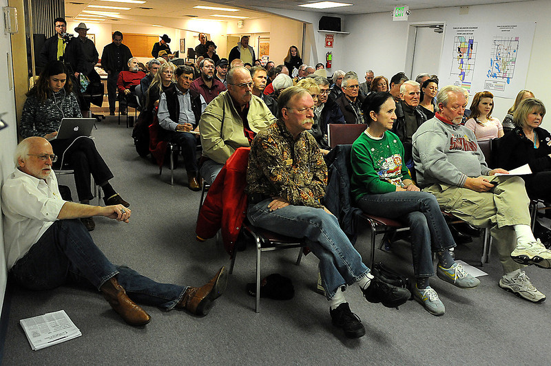 A crowd listens to candidates for the vacant Larimer County Commissioner seat during a candidate forum Tuesday night at the Leeper Community Center in Wellington. Some members of the crowd are members of the Larimer County Republican Central Committee who will appoint the new commissioner.