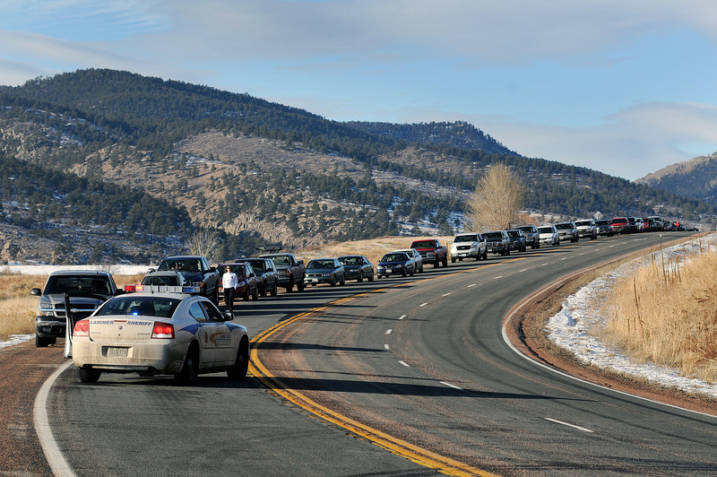 Motorists wait on West U.S. 34 as emergency crews clear an accident that happened about a half mile east of Sylvandale Guest Ranch on Monday afternoon. The accident stopped both directions of traffic for nearly two hours.