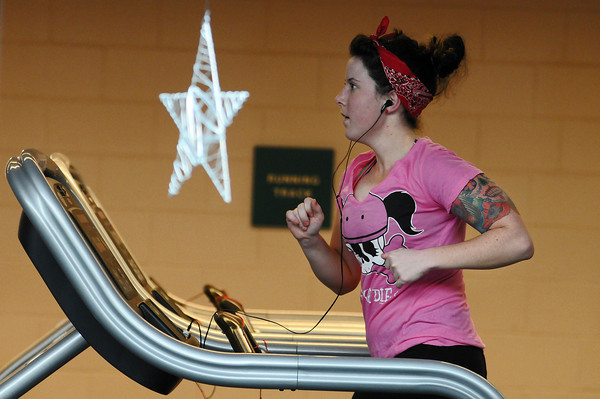 Elise Frucci of Loveland works out Sunday at the Chilson Recreation Center. Frucci says she didn't make any New Years resolutions but is working out three times a week to look her best at her July wedding.