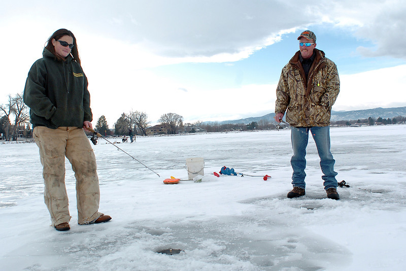 Greeley resident Courtney Lower, left, and Karl Bergersen of Loveland fish through the ice Saturday afternoon at Lake Loveland. Bergersen said the ice was about 8-1/2 inches thick and the water about 12 to 14 feet deep where they were fishing.