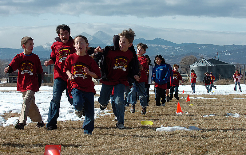 Berthoud Elementary fourth graders T.J Lucero, center left, and Elliot Read, right, joke around as they and Cole VonLintel left, and Elizabeth Netschke, center, run as many laps as they can during a school-wide jog-a-thon to raise funds for school field trips at Berthoud Elementary on Tuesday.