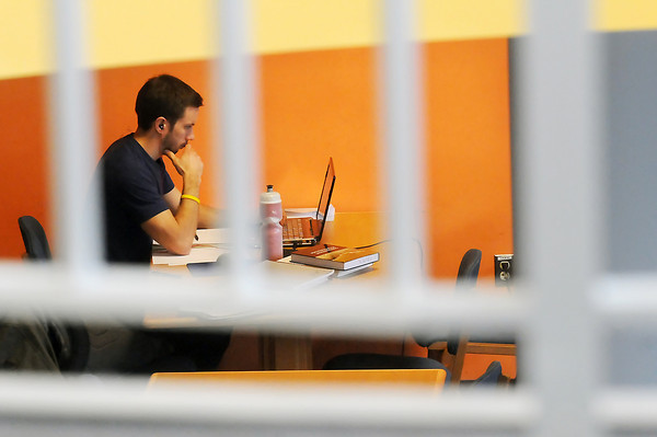Colorado State University graduate student Jon Pink studies in the Journal Room at Morgan Library on Thursday afternoon.