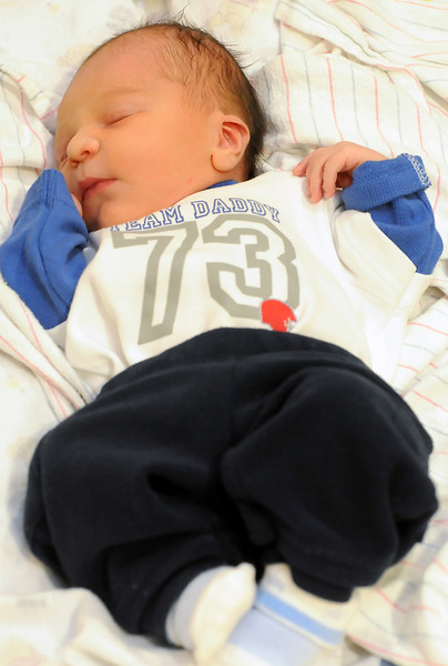 Loveland's first baby of 2011, Devin Manuel Hernandez, sleeps in his mother Carly Riemenschneider's room at McKee Medical Center on Saturday.