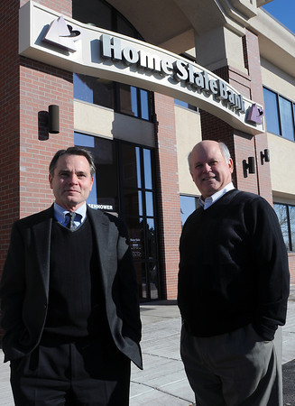Home State Bank Chairman of the Board Jack Devereaux, left, and his brother, Harry Devereaux, who is bank president, pose Thursday morning outside the bank's west Loveland branch at 2695 W. Eisenhower Blvd.