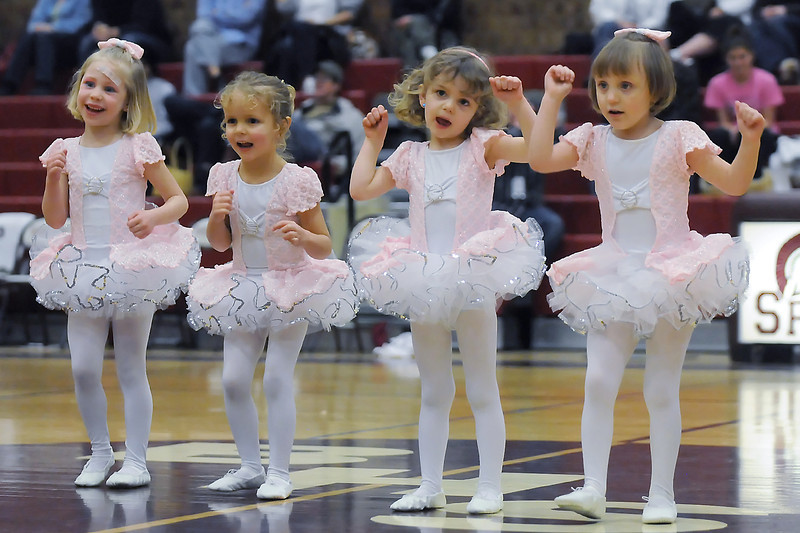 "Dancers from the Just For Kix dance class perform a dance to the song ""I'm cute"" during halftime of Berthoud High School's boys basketball game Saturday at BHS. From left are Elsie Unverzagt, 4, of Johnstown, Shaylee Spears, 3, of Berthoud, Addison Smith, 3, of Loveland and Claire Stogner, 4, also of Berthoud."