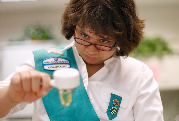 Evyn Batie, 10, who is a Girl Scout in Troop 2372, drizzles honey into the granola that will top some Thank U Berry Munch Granola and Yogurt Parfait on Sunday at First United Methodist Church. Batie was demonstrating recipes that use Girl Scout Cookies. Photos by Gabriel Christus