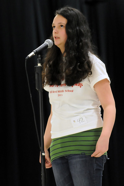 """Rocky Eisentraut, 13, an eighth grader from Bill Reed Middle School, spells the word """"widget"""" in the final round to become champion of the 14th Annual Thompson School District Spelling Bee on Saturday at Walt Clark Middle School. Eisentraut, along with the other top six finishers, earned the privilege to participate in the Denver Post Colorado State Spelling Bee in March."""