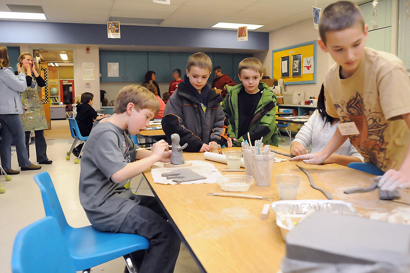 Teachers, parents and students gather in the art room at Garfield Elementary School during an open house event Thursday evening at the school. Front from left are Connor Leichliter, 10, Christopher Black, 7, Michael Black, 7, Dusty Rodriguez, 10, and Anthony Peek, 11.