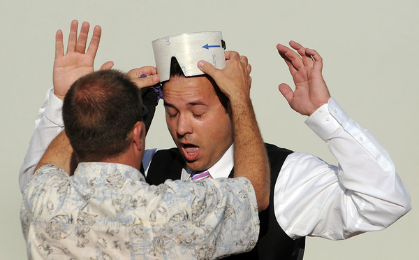 Magician Jack Stephens reacts as city council candidate Bob Snyder removes a blindfold following a magic stunt in which he drove around the Promenade Shops blindfolded on Thursday.
