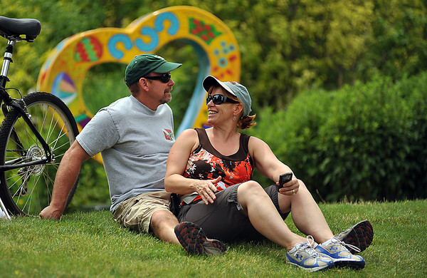 Judy Walters shares a moment with her husband, Mike Walters Sunday during SummerFest near downtown Loveland. The festival offered live music, carnival games, rides, food and plenty of vendor booths to peruse making it a good place for all ages.