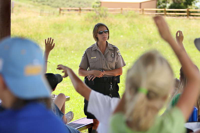 Park Ranger Babbett Phepps talks about her job and answers questions from kids in the Lory State Park's Junior Ranger Adventure Program Tuesday at Lory State Park.  The program teaches kids about hiking safety and about some of the native wildlife in Lory State Park.
