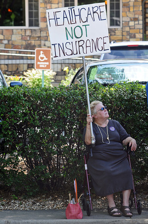 Louise Fjeld of Loveland show her support for healthcare reform on Thursday at Sen. Michael Bennet's office in Fort Collins.