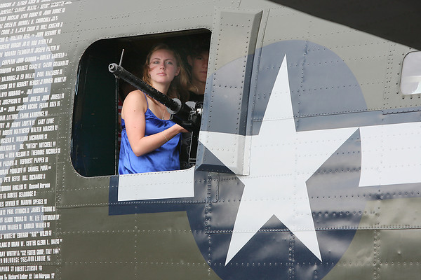 "Danica Smelzer the granddaughter of Marian Lilker, and Justin Erickson look out the window of ""Witchcraft,"" a B-24 bomber at the Fort Collins-Loveland Municipal Airport Friday."
