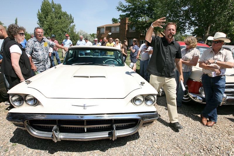 O.J. Pratt, owner of Pacific Auction Companies, Inc., takes bids on a 1960 Thunderbird during an estate auction of former racecar driver, Fritz Wilson, Satuday in Loveland. Wilson died in 2007.