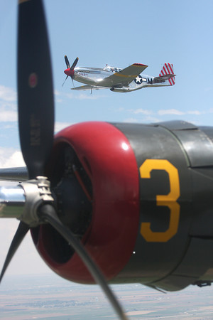 """Betty Jane"", a P-51 Mustang, escorts ""Witchcraft,"" a B-24 bomber, to the Fort Collins-Loveland Municipal Airport from Broomfield's Rocky Mountain Metroploitan Airport as a part of the Wings of Freedom tour on Friday."